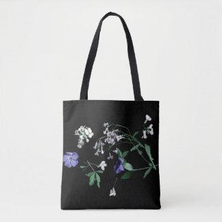 Fleurs de ressort sur le sac fourre-tout noir