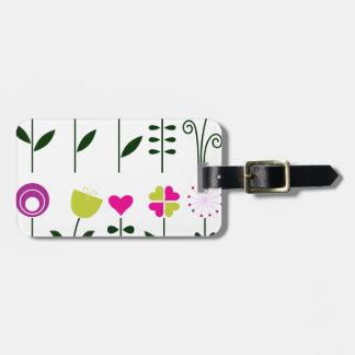 Fleurs folkloriques de luxe sur le blanc étiquette à bagage