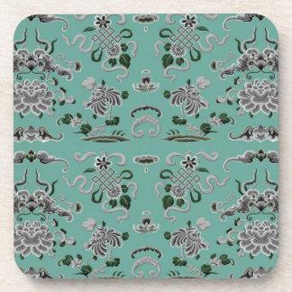 Fleurs grises et turquoises et formes sous-bock