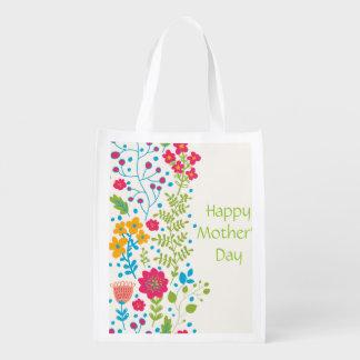 Fleurs heureuses de ressort du jour de mère sacs d'épicerie