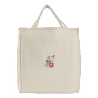 Fleurs mignonnes et un sac fourre-tout brodé par p