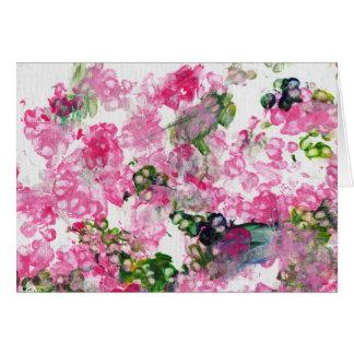Fleurs roses de patte carte de vœux