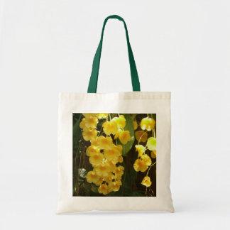 Fleurs tropicales accrochantes d'orchidées jaunes sac