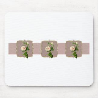 Fleurs vintages rose-clair au loin tapis de souris