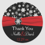 Flocons de neige noirs, blancs, rouges épousant autocollant rond