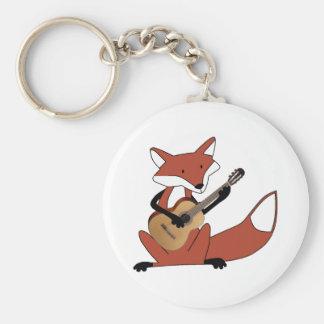 Fox jouant la guitare porte-clé rond