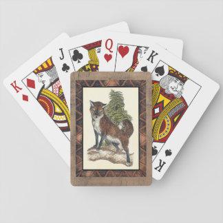 Fox rustique faisant un pas sur un tronc d'arbre cartes à jouer