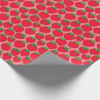 Fraises rouges sur le rose papier cadeau