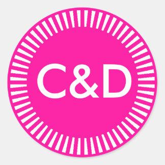 Frontière rayonnante de deux initiales faites sur sticker rond