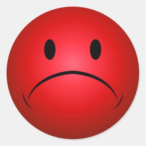 Frownie rouge font face à l'autocollant