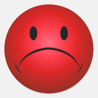 Frownie rouge font face à l'autocollant sticker rond