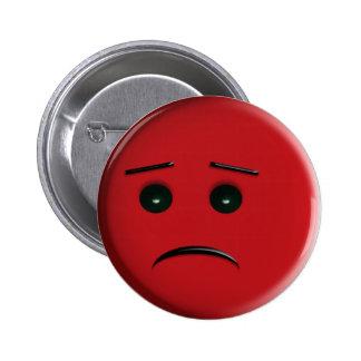 Frowny rouge font face badge avec épingle