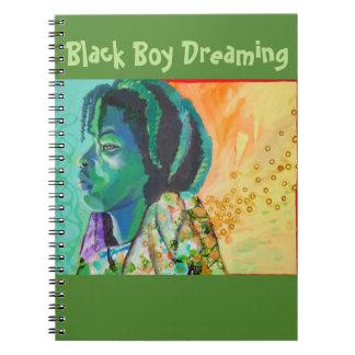 Garçon noir rêvant le carnet