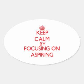 Gardez le calme en se concentrant sur aspirer autocollant ovale