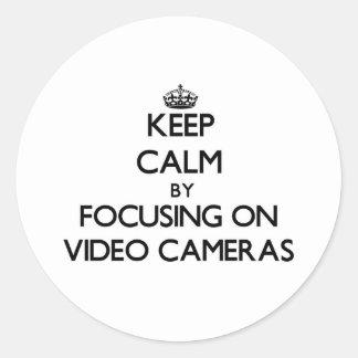 Gardez le calme en se concentrant sur des caméras autocollants ronds