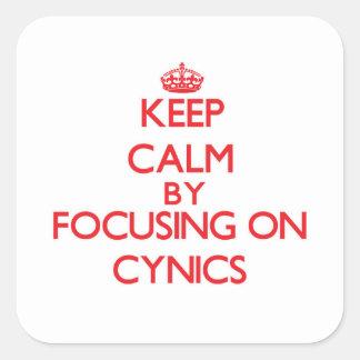 Gardez le calme en se concentrant sur des cyniques autocollants carrés