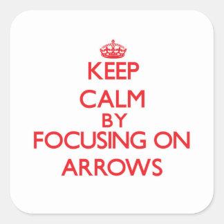 Gardez le calme en se concentrant sur des flèches autocollants