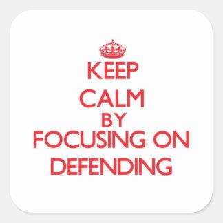Gardez le calme en se concentrant sur la défense sticker carré