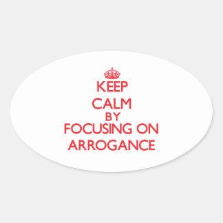 Gardez le calme en se concentrant sur l'arrogance autocollants ovales