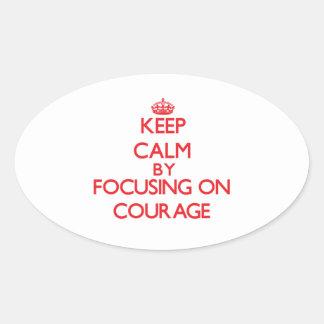 Gardez le calme en se concentrant sur le courage sticker ovale