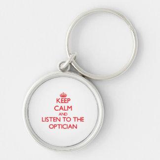 Gardez le calme et écoutez l'opticien porte-clé rond argenté