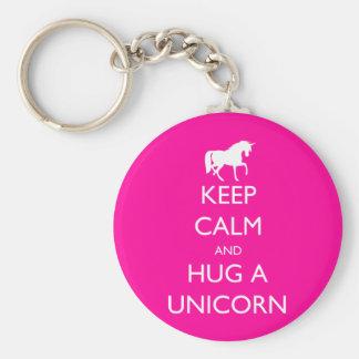 Gardez le calme et étreignez une licorne porte-clé rond