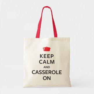 Gardez le calme et la cocotte en terre dessus sacs de toile