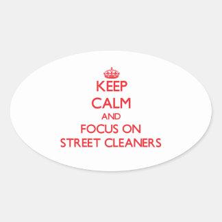 Gardez le calme et le foyer sur des balayeuses stickers ovales