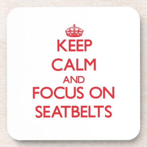 Gardez le calme et le foyer sur des ceintures de s sous-bock