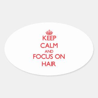 Gardez le calme et le foyer sur des cheveux autocollants ovales