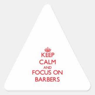 Gardez le calme et le foyer sur des coiffeurs