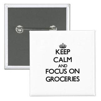 Gardez le calme et le foyer sur des épiceries badges