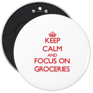 Gardez le calme et le foyer sur des épiceries badges avec agrafe