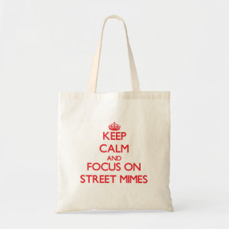 Gardez le calme et le foyer sur des pantomimes de sacs de toile
