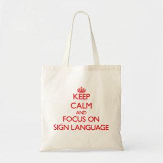 Gardez le calme et le foyer sur la langue des sac en toile