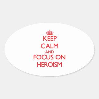Gardez le calme et le foyer sur le héroisme autocollants ovales