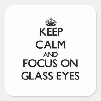 Gardez le calme et le foyer sur les yeux en verre stickers carrés