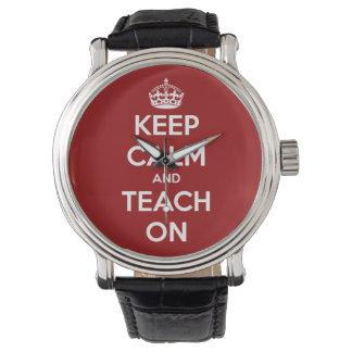 Gardez le calme et l'enseignez sur la montre rouge