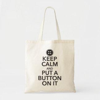 Gardez le calme et mettez un bouton là-dessus sac de toile