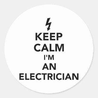 Gardez le calme que je suis un électricien sticker rond