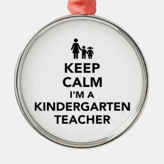 Gardez le calme que je suis une institutrice ornement rond argenté