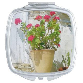 Géranium rouge d'aquarelle miroir compact