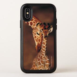 Girafe adulte avec le veau (camelopardalis de