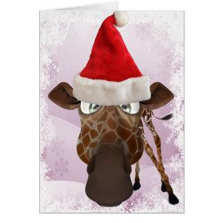 Girafe drôle avec la carte de Noël de casquette de