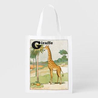 Girafe mangeant l'acacia dans le désert sac réutilisable
