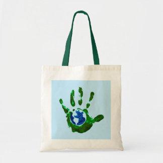 Globe dans le sac fourre-tout à Handprint