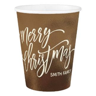 Gobelets En Papier Typographie de Joyeux Noël sur la texture crémeuse