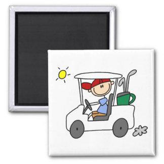 Golfeur dans le chariot de golf aimant