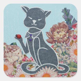 Grand autocollant arrondi avec le chat, les fleurs