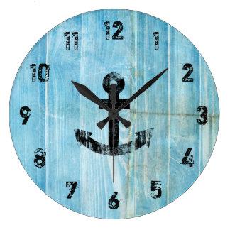 Grande Horloge Ronde Ancre nautique noire vintage sur le bois bleu